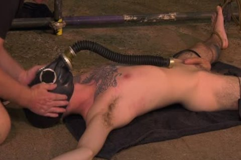 Roped Down twink acquires A Gas Mask And A rough handjob